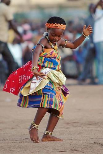 A young Ghanaian child doing Akan Adowa dance